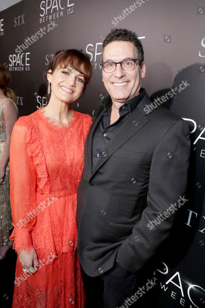 "Carla Gugino and Oren Aviv, President and Chief Content Officer for Motion Picture Group, STX Entertainment, seen at STX Entertainment Los Angeles Special Screening of ""The Space Between Us"" at ArcLight Hollywood, in Los Angeles"