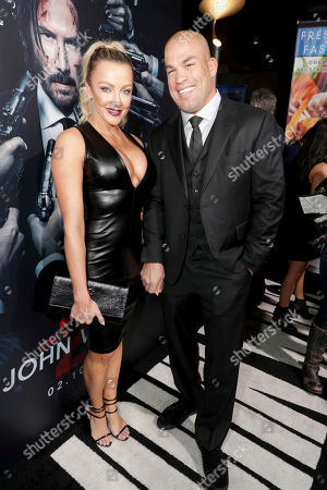 """Amber Nicole Miller and Tito Ortiz seen at Summit Entertainment, a Lionsgate Company, Los Angeles Premiere of """"John Wick Chapter 2"""" at ArcLight Hollywood, in Los Angeles"""
