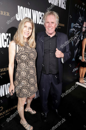 """Steffanie Sampson and Gary Busey seen at Summit Entertainment, a Lionsgate Company, Los Angeles Premiere of """"John Wick Chapter 2"""" at ArcLight Hollywood, in Los Angeles"""