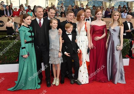 Samantha Isler, from left, Viggo Mortensen, Matt Ross, Shree Crooks, Nicholas Hamilton, Charlie Shotwell, Trin Miller, George MacKay, Annalise Basso, and Erin Moriarty arrive at the 23rd annual Screen Actors Guild Awards at the Shrine Auditorium & Expo Hall, in Los Angeles