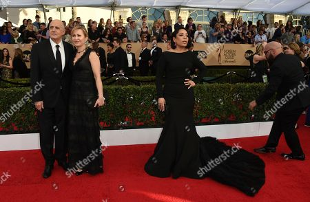 Jeffrey Tambor, from left, Kasia Ostlun, and Selenis Leyva arrive at the 23rd annual Screen Actors Guild Awards at the Shrine Auditorium & Expo Hall, in Los Angeles