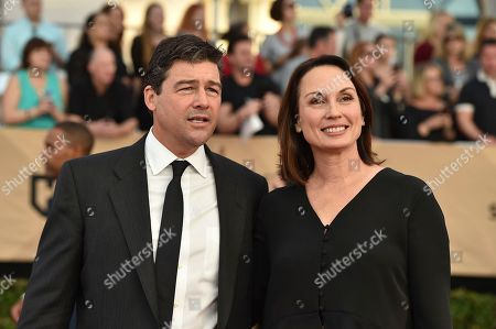 Kyle Chandler, left, and Kathryn Chandler arrive at the 23rd annual Screen Actors Guild Awards at the Shrine Auditorium & Expo Hall, in Los Angeles