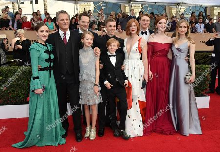 "The cast of ""Captain Fantastic,"" from left, Samantha Isler, Viggo Mortensen, writer-director Matt Ross, Shree Crooks, Nicholas Hamilton, Charlie Shotwell, foreground, Trin Miller, George MacKay, Annalise Basso, and Erin Moriarty arrive at the 23rd annual Screen Actors Guild Awards at the Shrine Auditorium & Expo Hall, in Los Angeles"
