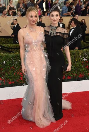 Kaley Cuoco, left, and Briana Cuoco arrive at the 23rd annual Screen Actors Guild Awards at the Shrine Auditorium & Expo Hall, in Los Angeles