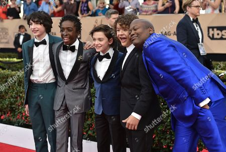 Stock Image of Finn Wolfhard, from left, Caleb McLaughlin, Noah Schnapp, Gaten Matarazzo, and Tituss Burgess arrive at the 23rd annual Screen Actors Guild Awards at the Shrine Auditorium & Expo Hall, in Los Angeles