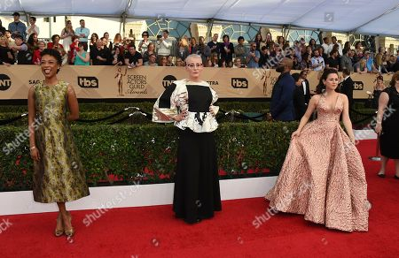Samira Wiley, from left, Lori Petty and Yael Stone arrive at the 23rd annual Screen Actors Guild Awards at the Shrine Auditorium & Expo Hall, in Los Angeles