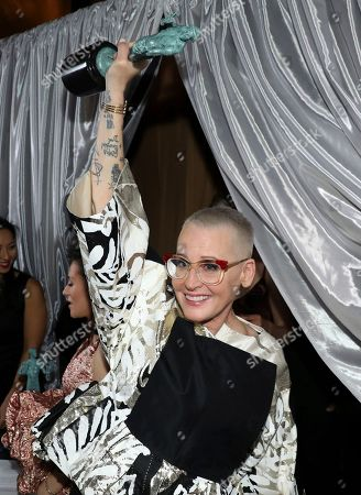 """Lori Petty, winner of the award for outstanding performance by an ensemble in a comedy series for """"Orange is the New Black"""", appears backstage at the 23rd annual Screen Actors Guild Awards at the Shrine Auditorium & Expo Hall, in Los Angeles"""