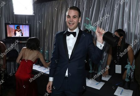 """Alan Aisenberg, winner of the award for outstanding performance by an ensemble in a comedy series for """"Orange is the New Black"""", appears backstage at the 23rd annual Screen Actors Guild Awards at the Shrine Auditorium & Expo Hall, in Los Angeles"""