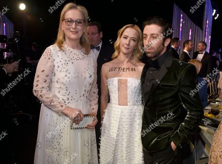Meryl Streep, from left, Jocelyn Towne, and Simon Helberg attend the 23rd annual Screen Actors Guild Awards at the Shrine Auditorium & Expo Hall, in Los Angeles