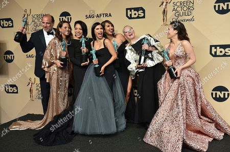 Nick Sandow, from left, Elizabeth Rodriguez, Selenis Leyva, Diane Guerrero, Jackie Cruz, Lori Petty and Yael Stone pose in the press room with the awards for the award for outstanding performance by an ensemble in a comedy series at the 23rd annual Screen Actors Guild Awards at the Shrine Auditorium & Expo Hall, in Los Angeles