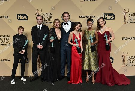 "Abigail Savage, from left, James McMenamin, Emily Althaus, Alan Aisenberg, Kimiko Glen, Samira Wiley and Julie Lakepose in the press room with the awards for outstanding performance by an ensemble in a comedy series for ""Orange is the New Black"" at the 23rd annual Screen Actors Guild Awards at the Shrine Auditorium & Expo Hall, in Los Angeles"