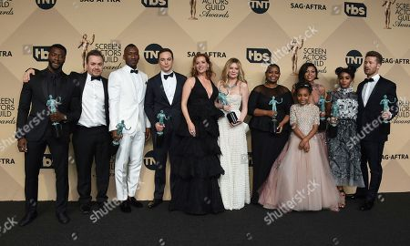 """Aldis Hodge, from left, Theodore Melfi, Mahershala Ali, Jim Parsons, Kimberly Quinn, Kristen Dunst, Octavia Spencer, Saniyya Sidney, Taraji P. Henson, Janelle Monae, and Glen Powell pose in the press room with the awards for outstanding performance by a cast in a motion picture for """"Hidden Figures"""" at the 23rd annual Screen Actors Guild Awards at the Shrine Auditorium & Expo Hall, in Los Angeles"""