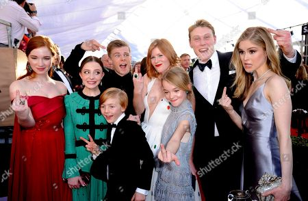 Annalise Basso, from left, Samantha Isler, Nicholas Hamilton, Charlie Shotwell, Trin Miller, Shree Crooks, George MacKay, and Erin Moriarty arrive at the 23rd annual Screen Actors Guild Awards at the Shrine Auditorium & Expo Hall, in Los Angeles