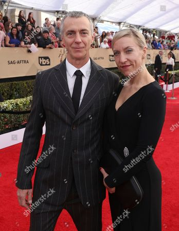 Mark Steger, left, and guest arrive at the 23rd annual Screen Actors Guild Awards at the Shrine Auditorium & Expo Hall, in Los Angeles