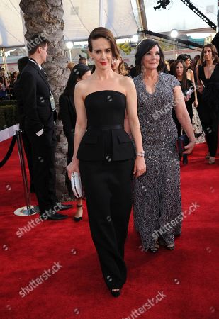 Sarah Paulson, left, and Marcia Clark arrive at the 23rd annual Screen Actors Guild Awards at the Shrine Auditorium & Expo Hall, in Los Angeles