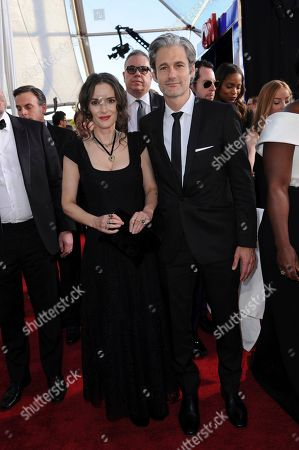 Winona Ryder, left, and Scott Mackinlay Hahn arrive at the 23rd annual Screen Actors Guild Awards at the Shrine Auditorium & Expo Hall, in Los Angeles
