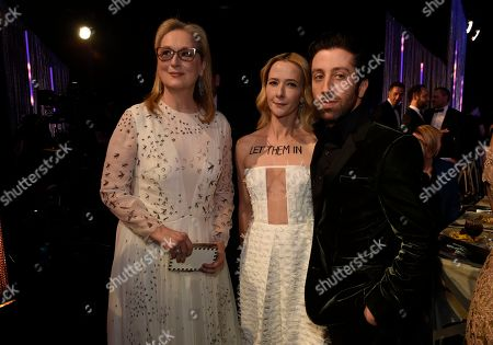 Meryl Streep, from left, Jocelyn Towne and Simon Helberg attend the 23rd annual Screen Actors Guild Awards at the Shrine Auditorium & Expo Hall, in Los Angeles
