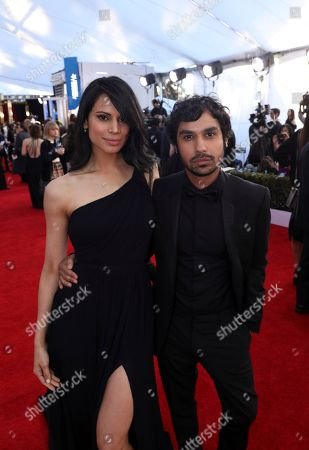 Neha Kapur, left, and Kunal Nayyar arrive at the 23rd annual Screen Actors Guild Awards at the Shrine Auditorium & Expo Hall, in Los Angeles