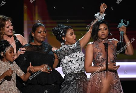 """Stock Image of Taraji P. Henson, from right, Janelle Monae, Octavia Spencer, Kimberly Quinn, and Saniyya Sidney, foreground left, accept the award for outstanding performance by a cast in a motion picture for """"Hidden Figures"""" at the 23rd annual Screen Actors Guild Awards at the Shrine Auditorium & Expo Hall, in Los Angeles"""