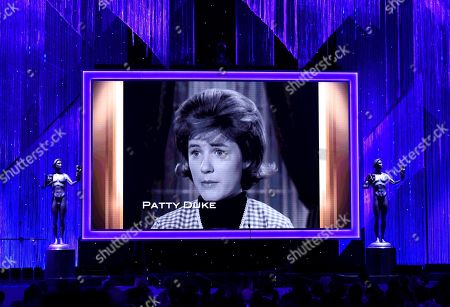 Stock Photo of Patty Duke is pictured on screen during an In Memoriam tribute at the 23rd annual Screen Actors Guild Awards at the Shrine Auditorium & Expo Hall, in Los Angeles