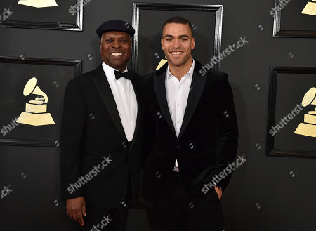 Booker T. Jones, left, and Ted Jones arrive at the 59th annual Grammy Awards at the Staples Center, in Los Angeles
