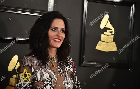 Juliette Larthe arrives at the 59th annual Grammy Awards at the Staples Center, in Los Angeles