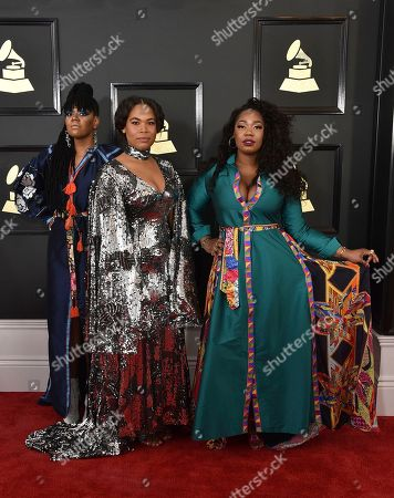 Stock Photo of Amber Strother, from left, Anita Bias, and Paris Strother of the musical group King arrive at the 59th annual Grammy Awards at the Staples Center, in Los Angeles