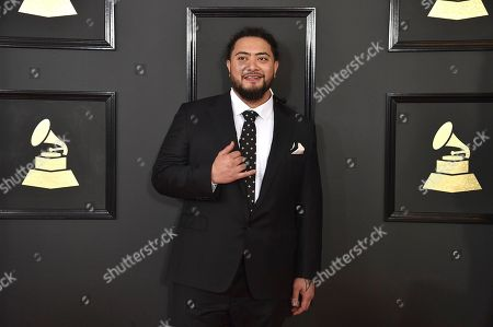 J. Boog arrives at the 59th annual Grammy Awards at the Staples Center, in Los Angeles