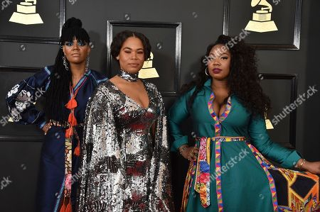 Amber Strother, from left, Anita Bias, and Paris Strother of the musical group King arrive at the 59th annual Grammy Awards at the Staples Center, in Los Angeles