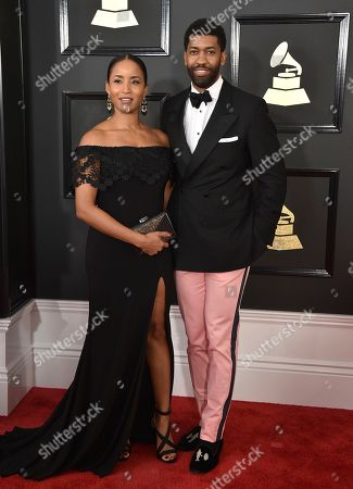 Faune Watkins, left, and Derek Watkins aka Fonzworth Bentley arrive at the 59th annual Grammy Awards at the Staples Center, in Los Angeles