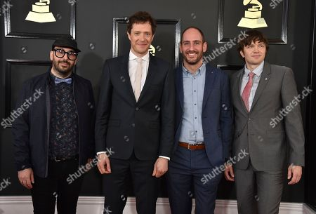 Tim Nordwind, from left, Damian Kulash, Dan Konopka, and Andy Ross of the musical group OK Go arrive at the 59th annual Grammy Awards at the Staples Center, in Los Angeles