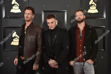 Ryan Meyer, from left, Johnny Stevens, and Rich Meyer of the musical group Highly Suspect arrive at the 59th annual Grammy Awards at the Staples Center, in Los Angeles
