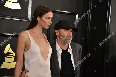 Jessica Miller, left, and Lars Ulrich arrive at the 59th annual Grammy Awards at the Staples Center, in Los Angeles