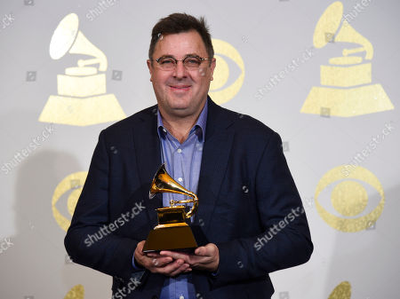 "Stock Photo of Vince Gill, of The Time Jumpers, poses in the press room with the award for best American roots song for ""Kid Sister"" at the 59th annual Grammy Awards at the Staples Center, in Los Angeles"