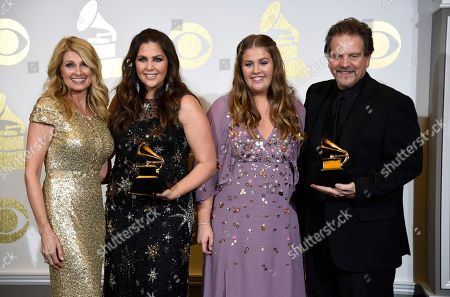 """Linda Davis, from left, Hillary Scott, Rylee Scott, and Lang Scott pose in the press room with with the awards for best contemporary christian music album for """"Love Remains"""" and best contemporary christian music song for """"Thy Will"""" at the 59th annual Grammy Awards at the Staples Center, in Los Angeles"""