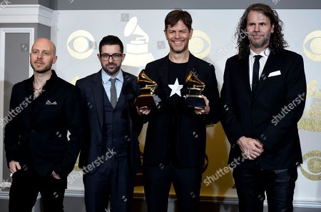 "Jason Lindner, from left, Mark Guiliana, Donny McCaslin, and Tim Lefebvre pose in the press room with the award for best alternative music album for ""Backstair"" by David Bowie at the 59th annual Grammy Awards at the Staples Center, in Los Angeles"