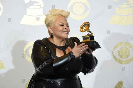"Tamela Mann poses in the press room with the award for best gospel performance/song for ""God Provides"" at the 59th annual Grammy Awards at the Staples Center, in Los Angeles"