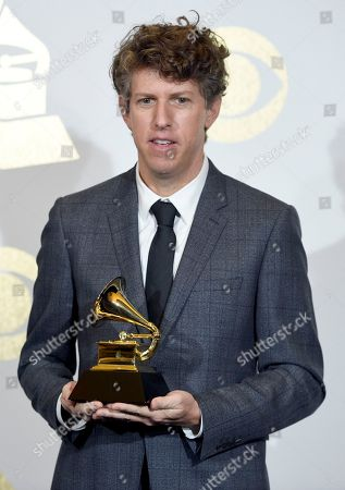 Greg Kurstin poses in the press room with the producer of the year, non-classical award at the 59th annual Grammy Awards at the Staples Center, in Los Angeles