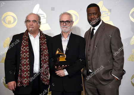 """Steve Berkowitz, from left, Jeff Rosen, and Robert Glasper pose in the press room with the award for best compilation soundtrack for visual media for """"Miles Ahead (Miles David & Various Artists) at the 59th annual Grammy Awards at the Staples Center, in Los Angeles"""