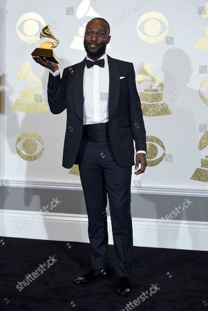 """Paul Jefferies poses in the press room with the award for best rap song for """"Hotline Bling"""" at the 59th annual Grammy Awards at the Staples Center, in Los Angeles"""