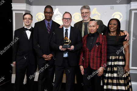 """Stock Photo of Van Dean, from left, Stephen Bray, Scott Sanders, Frank Filipetti, Jhett Tolentino, and Brenda Russell pose in the press room with the award for best musical theater album for """"The Color Purple"""" at the 59th annual Grammy Awards at the Staples Center, in Los Angeles"""