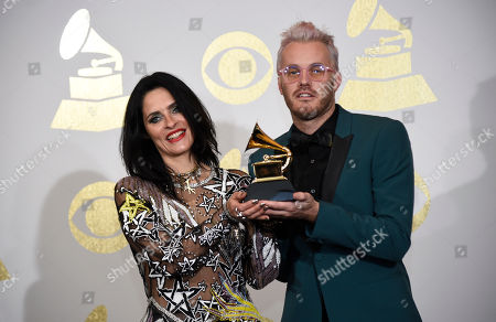 """Juliette Larthe, left, and Nathan Scherrer pose in the press room with the award for best music video for """"Formation"""" by Beyonce at the 59th annual Grammy Awards at the Staples Center, in Los Angeles"""