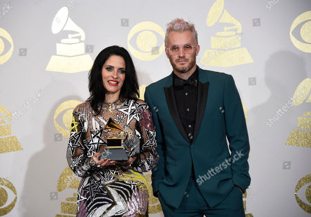 Stock Picture of Juliette Larthe, left, and Nathan Scherrer pose in the press room with the award for best music video for 'Formation' by Beyonce at the 59th annual Grammy Awards at the Staples Center, in Los Angeles