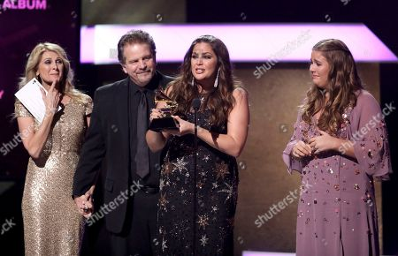 """Linda Davis, from left, Lang Scott, Hillary Scott, and Rylee Scott accept the award for best contemporary christian music album for """"Love Remains"""" at the 59th annual Grammy Awards, in Los Angeles"""