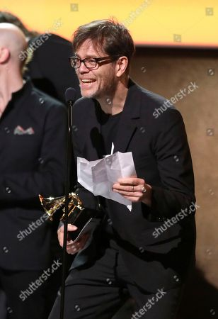 "Donny McCaslin accepts the award for best alternative music album for ""Backstar"" by David Bowie at the 59th annual Grammy Awards, in Los Angeles"