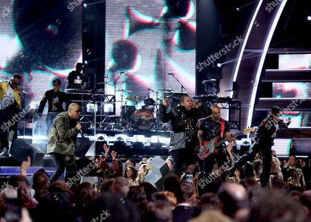 Ali Shaheed Muhammad, left, and Jarobi White, from A Tribe Called Quest, perform at the 59th annual Grammy Awards, in Los Angeles