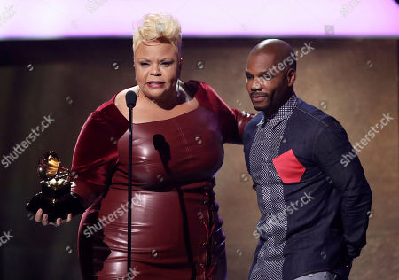 "Tamela Mann, left, and Kirk Franklin accept the award for best gospel performance/song for ""God Provides"" at the 59th annual Grammy Awards, in Los Angeles"