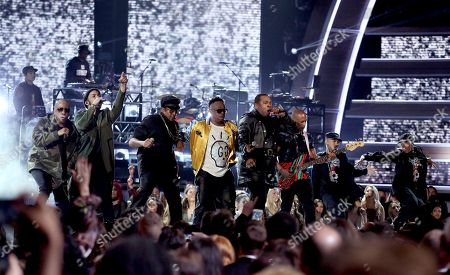Ali Shaheed Muhammad, from left, Anderson .Paak, Q-Tip, Jarobi White and Busta Rhymes perform at the 59th annual Grammy Awards, in Los Angeles