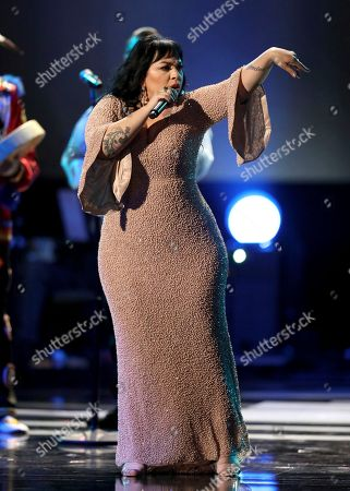 Mexican singer Carla Morrison performs at the 59th annual Grammy Awards, in Los Angeles