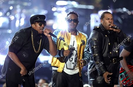 Q-Tip, from left, Jarobi White and Busta Rhymes perform at the 59th annual Grammy Awards, in Los Angeles